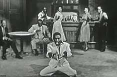 Sammy Davis Junior with other performers Singing and dancing onstage in the Colgate Summer Comedy Hour.